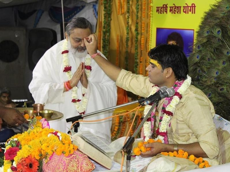 Acharya Updesh Krishna Shastri Ji is doing Tilak of Brahmachari Girish Ji on  5th april 2017   Ram Navami at Maharishi Ved Vigyan Vishwa Vidyapeetham campus Bhopal.
