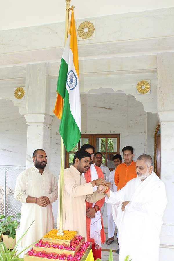 Brahmachari Girish Ji being blessed by Pandits with Raksha Sutra after National Flag Hoisting.