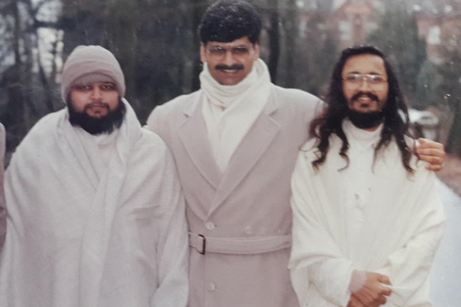 Brahmachari Girish Ji walking with Pt. Gopal Krishna Dave and Ved Prakash Sharma in forest near MERU, Holland, winter 1993