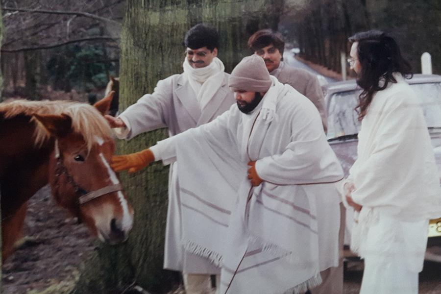 Brahmachari Girish Ji is playing with horse at forest near MERU, Holland, winter 1993